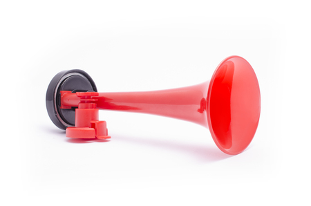 Red plastic horn isolated on white