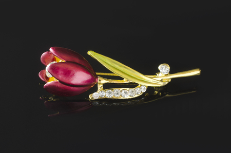 brooch tulip flower isolated on black