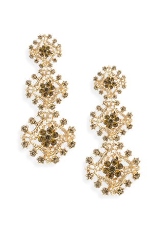 gold earrings with diamonds isolated on white Stock Photo