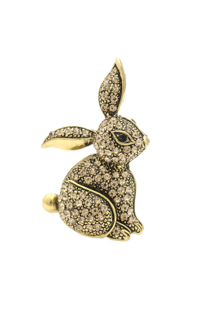 gold brooch bunny with diamonds isolated on white