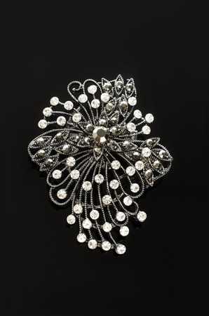 brooch with diamonds isolated on black background Stock Photo