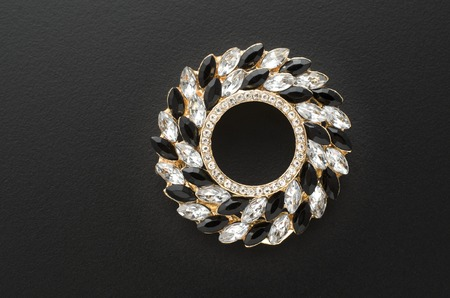 onyx: round brooch with gems isolated on black Stock Photo