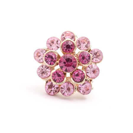 gold brooch flower with pink diamonds isolated on white
