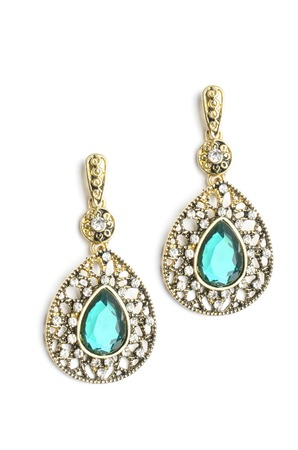 gold drop earrings with blue stone isolated on white