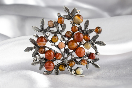 brooch tree with gems isolated on silk Stock Photo