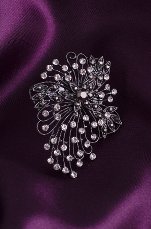 brooch with diamonds isolated on silk