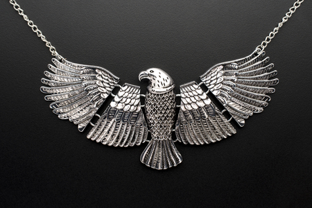 silver necklace eagle on a chain isolated on black