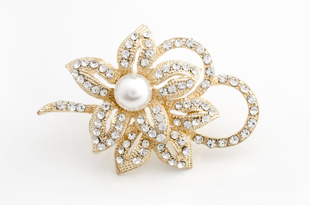 gold brooch flower with pearl isolated on white