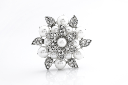 silver brooch flower with pearl on isolated on white 스톡 콘텐츠