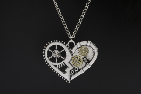 pendant heart in steampunk style isolated on black