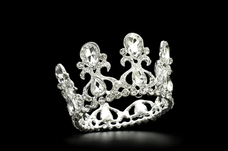 silver crown isolated in black background