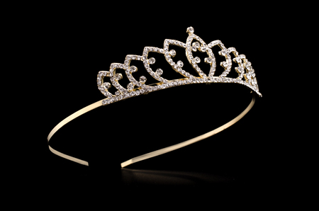 golden tiara with gems isolated on black background