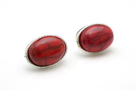 silver stud earrings with red stones isolated on white Stock Photo
