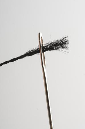 to thread a needle macro isolated on white