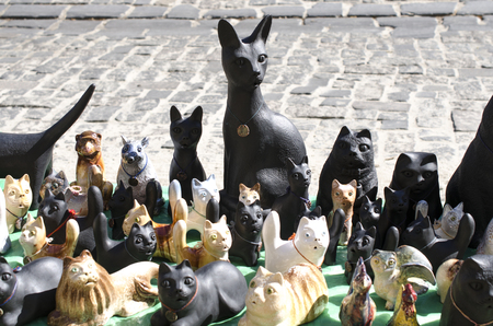 statuettes of cats on the street market