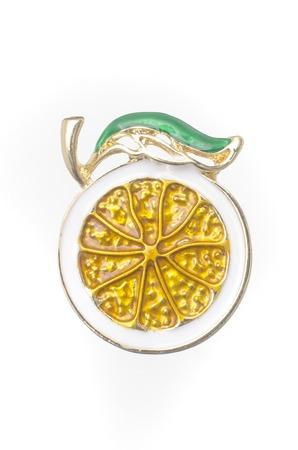 lemon enamelled brooch isolated on white