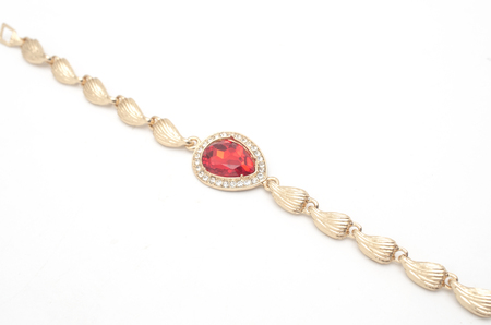 gold bracelet with ruby isolated on white Imagens
