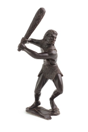 figurine primitive man with a bludgeon isolated on white