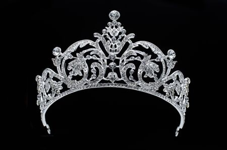 silver tiara with diamonds on black background