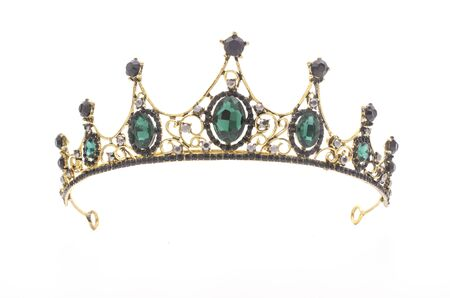 golden crown with emeralds on a white background Standard-Bild