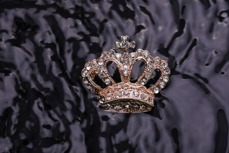 brooch golden crown in the water Stock Photo