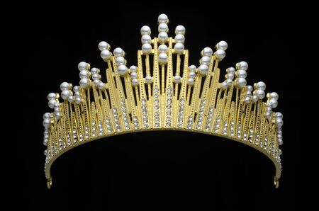 golden crown with pearls and diamonds isolated on black
