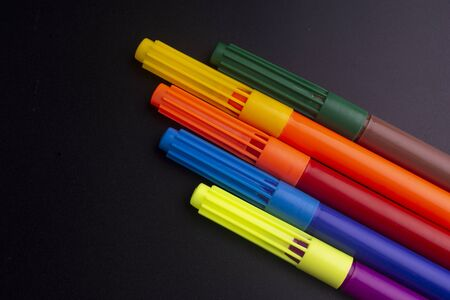 color felt-tip pens isolated on black Standard-Bild