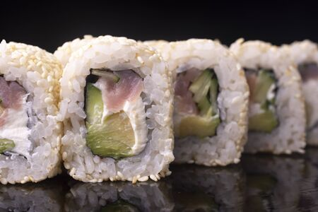 Japanese Sushi Rolls with Cream Cheese with red fish and cucumber