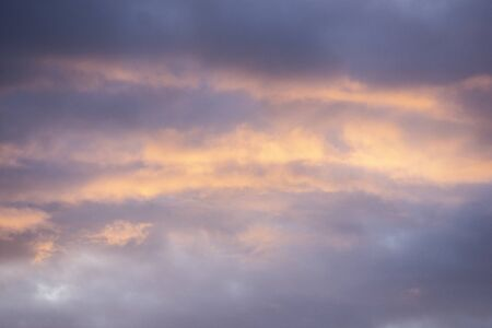 gently violet yellow clouds background
