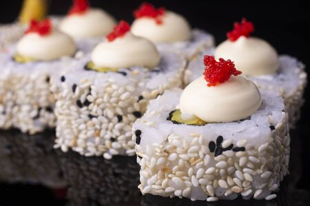Japanese Sushi Rolls with Cream Cheese , flying fish roe and sesame seeds