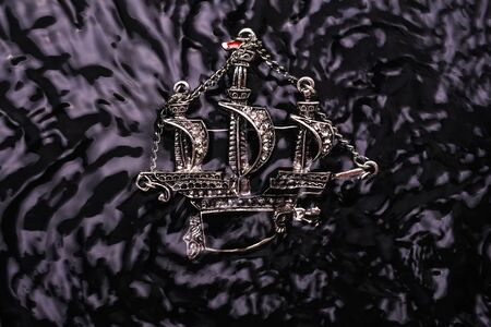 silver brooch ship with diamonds in the water