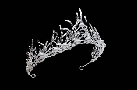 tiara with pearls isolated on a black background Standard-Bild