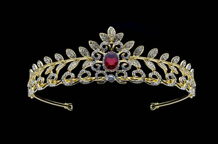 golden crown with rubies  on a black background Stock Photo