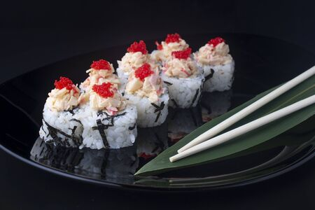 Japanese Sushi Rolls with Cream Cheese and flying fish roe Standard-Bild