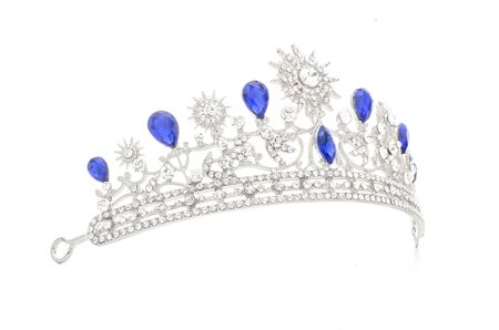 silver tiara with diamonds and sapphires on black