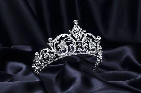 silver tiara with diamonds on black silk