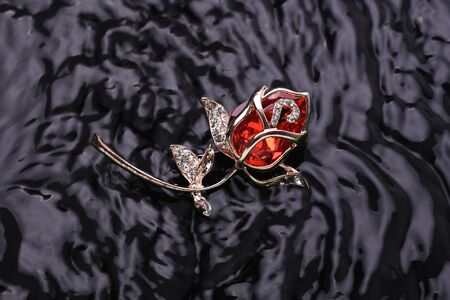 brooch rose with diamonds and a big ruby fish in the water