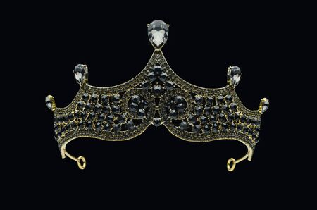 tiara with black stones and diamonds isolated on black