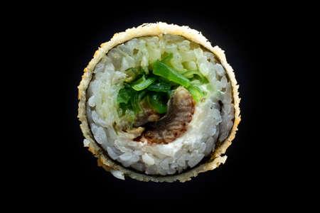 Baked sushi roll on dark background Imagens