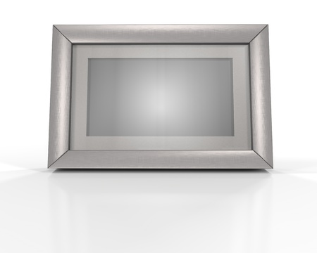 Blank silver picture frame at the desk with clipping path photo