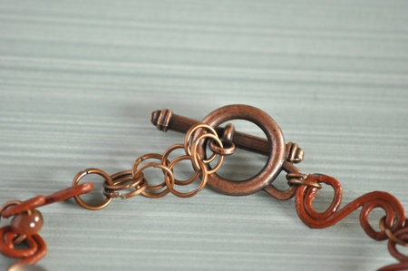 clasp: Part of jewellery with copper colour clasp.