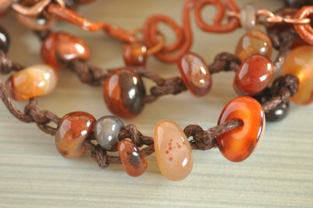 Jewellery in brown colours made from cord and agate stones. photo