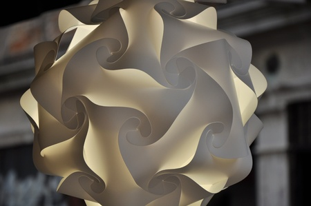 curlicues: Lighting abstract shape lamp with curlicues and loops. Stock Photo