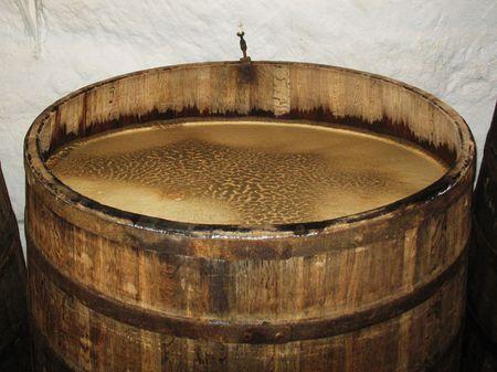 Big barrel full of aging beer in brewery storage Plsen Czech photo