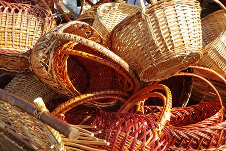 Old dray full of handmade wood baskets photo