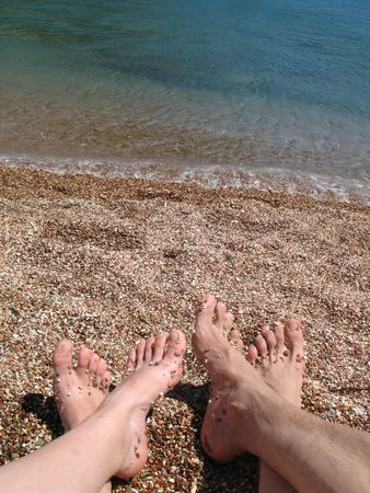 Two pair bare foot on the sea coast Stock Photo - 5537437
