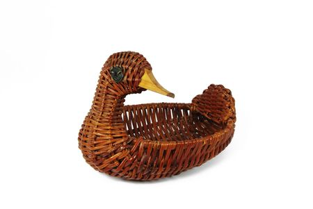 spliced: Wicker contaimer in form of duck on white background