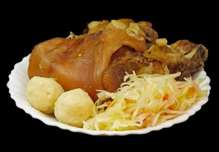 Griled pork knee with cabbage and pastry photo