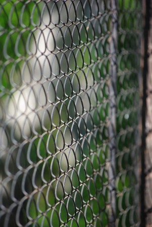 Chain link rusty fence limited focus distance image. Stock Photo - 7236431