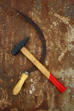 The soviet symbol sickle and hammer on rusty  background Stock Photo - 7236445